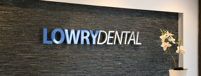 dental clinic name stone wall sign